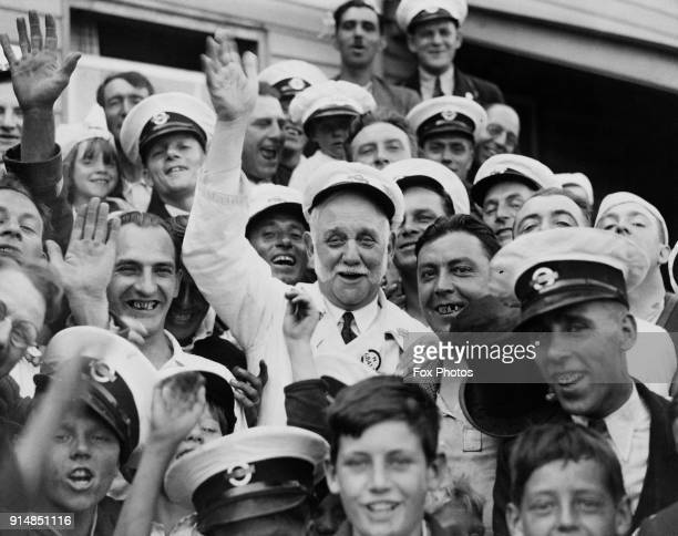 British Labour politician and social reformer George Lansbury the MP for Bow and Bromley helps London bus drivers entertain children at Theydon Bois...