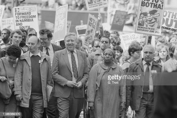 British Labour politician, author and journalist Roy Hattersley joins the Anti-Apartheid Movement's 'No to Botha' demonstration while British Prime...