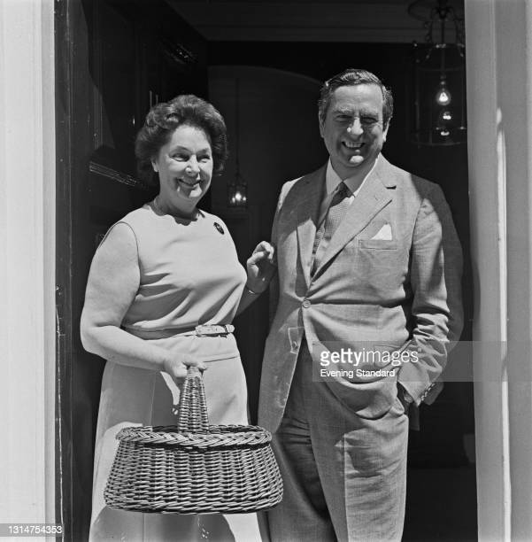 British Labour politician Denis Healey , Chancellor of the Exchequer, with his wife Edna , a writer and lecturer, at the door of 11 Downing Street in...