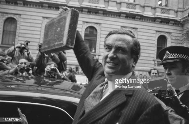 British Labour politician Denis Healey , the Chancellor of the Exchequer, leaves Downing Street for the House of Commons with his budget box and a...