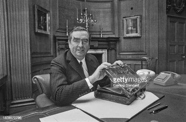 British Labour politician Denis Healey , the Chancellor of the Exchequer, with his budget box, UK, 12th November 1974.