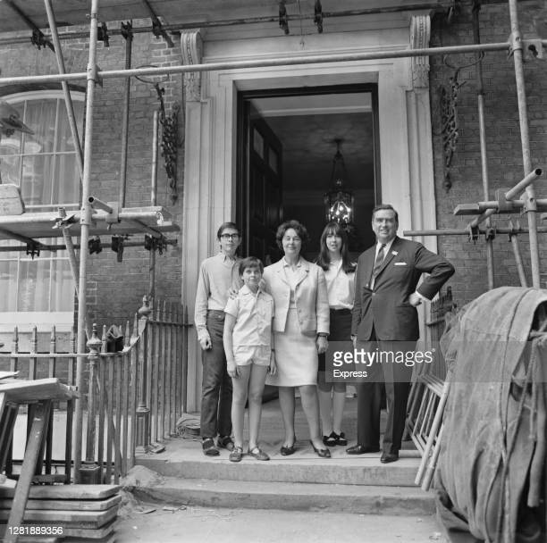 British Labour politician Denis Healey the Secretary of State for Defence moves into the Old Admiralty Building in Whitehall London with his wife...