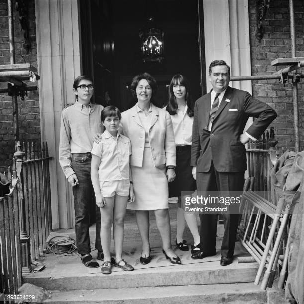 British Labour politician Denis Healey , the Secretary of State for Defence, moves into the Old Admiralty Building in Whitehall, London, with his...