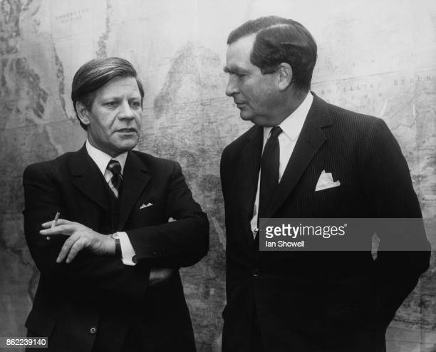 British Labour politician Denis Healey , the Secretary of State for Defence, meets Helmut Schmidt , the West German Defence Minister at the Ministry...