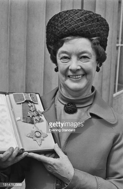 British Labour politician Evelyn Denington , a member of the GLC , during her investiture as Dame Commander of the Order of the British Empire at...