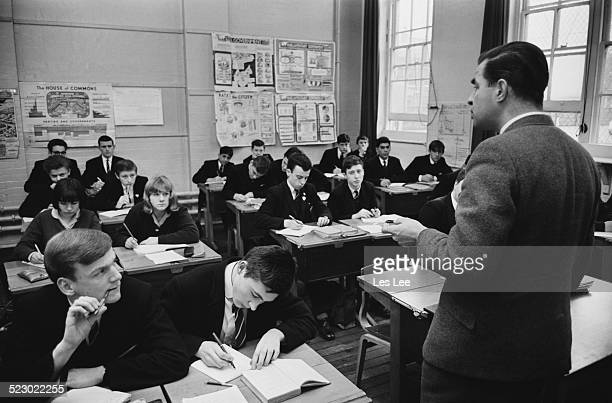 British Labour politician for Epping Stan Newens teaching a history class at Edith Cavell school, Hackney, London, 26th November 1964.