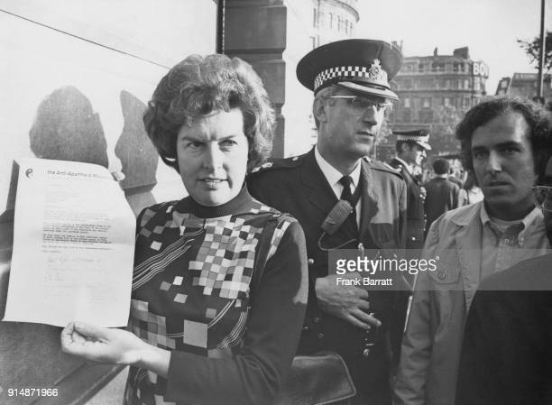 British Labour politician Joan Lestor and Peter Hain leader of the Young Liberals arrive at South Africa House in London with a letter of protest...
