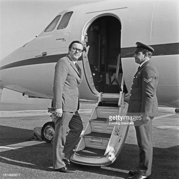 British Labour politician Merlyn Rees , the Secretary of State for Northern Ireland, boards an aircraft, UK, 4th June 1974.
