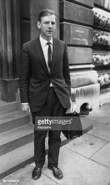 British Labour politician Peter Shore , the new Minister of Economic Affairs, leaves the Department of Economic Affairs in London, 30th August 1967.