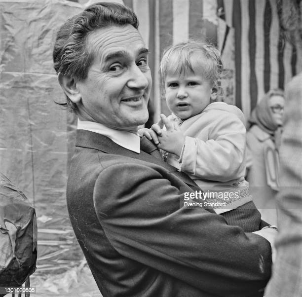British Labour politician Reg Freeson , the MP for Willesden East , holding a toddler during a protest in Queen's Park, Brent, London, UK, 31st May...