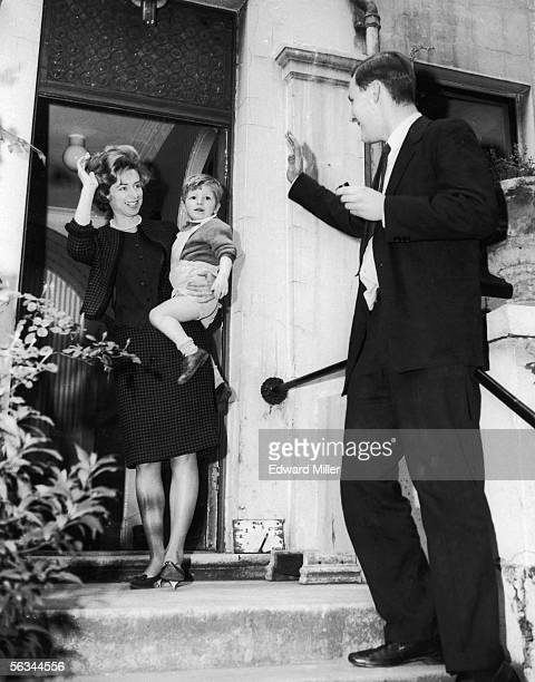 British Labour politician Tony Benn waves goodbye to his wife Caroline and son Joshua as he leaves for work from his home in Holland Park 8th May 1961