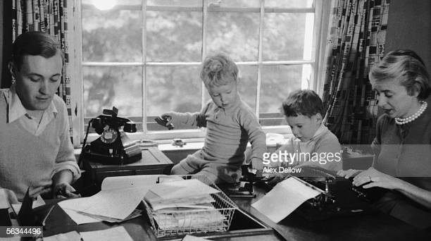 British Labour politician Tony Benn working at home with his wife Caroline and children Hilary and Stephen 29th October 1955 Original publication...