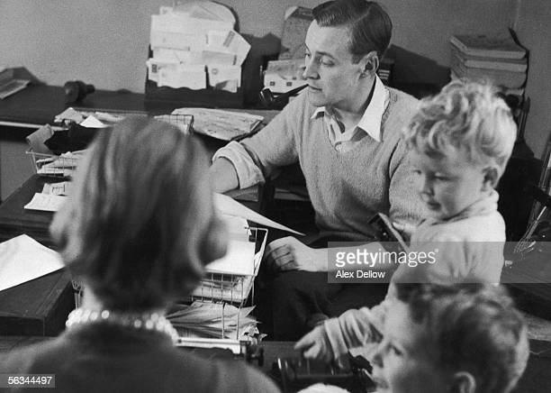 British Labour politician Tony Benn working at home with his wife Caroline and children Hilary left and Stephen 29th October 1955 Original...