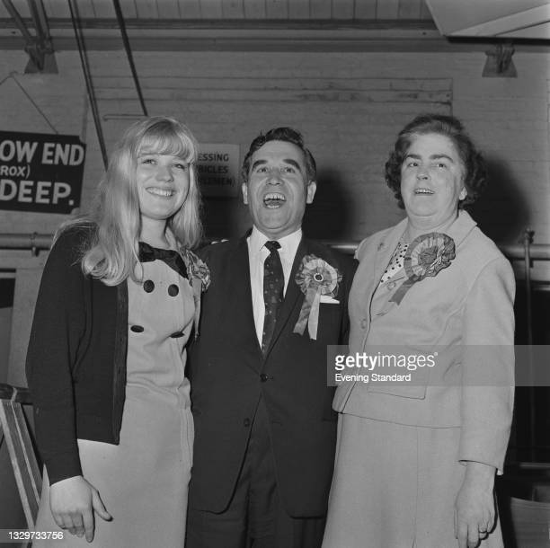 British Labour politician William Molloy with his wife Eva and daughter Marion, after being elected MP for Ealing North in the UK general election,...