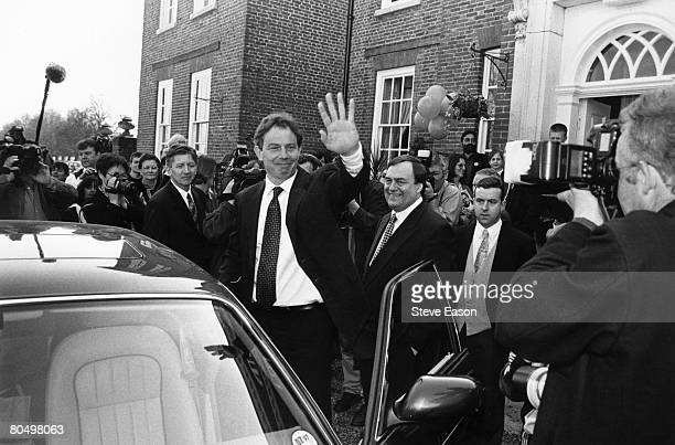 British Labour politicians Tony Blair and John Prescott flanked by photographers as they embark on their National Election campaign at Maidstone Kent...
