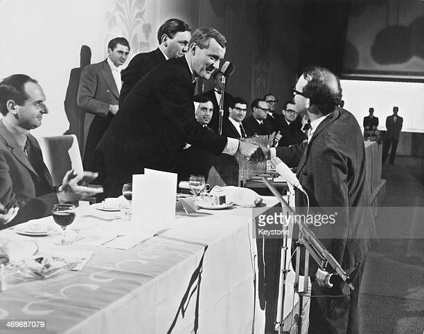 British Labour Postmaster General Tony Benn presents the ABC Television award for the most imaginative TV commercial to a representative of the Doyle...