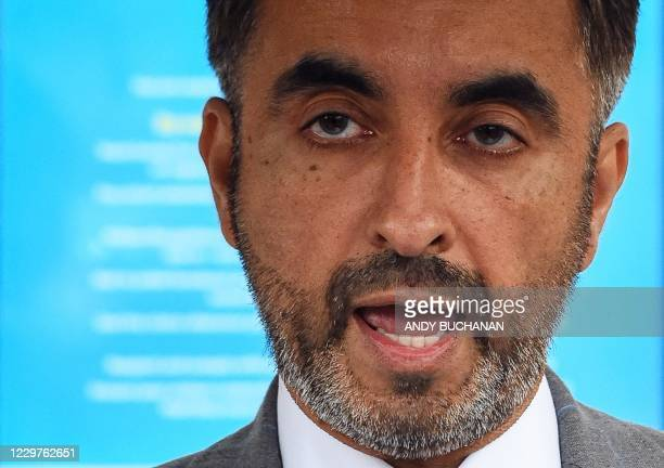 British lawyer Aamer Anwar reads a statement to the media in Glasgow on November 24, 2020 on the opening day of a posthumous appeal against the...