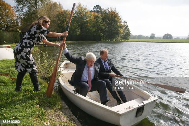 British lawyer and Boris Johnson's wife Marina Wheeler helps as Britain's Foreign Secretary Boris Johnson boards a row boat with Czech Republic's...