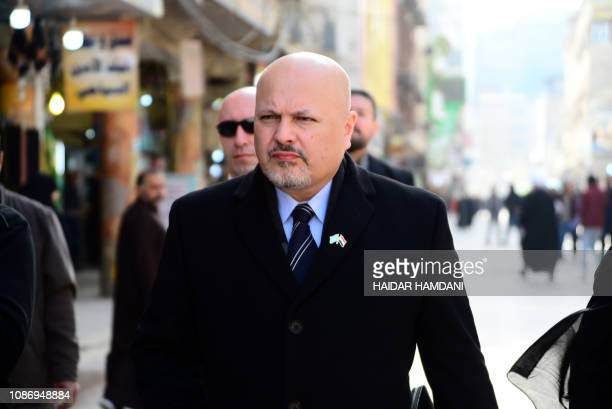 British lawyer Karim Asad Ahmad Khan walks in the streets of the holy city of Najaf in central Iraq during his visit to the wartorn country's Shiite...