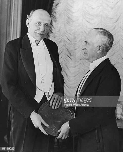 British lawyer scholar and politician Lord Cecil of Chelwood receives the first Woodrow Wilson Foundation award of $25 000 and a bronze medal from...