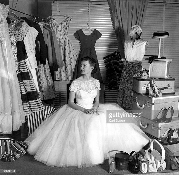 British leading lady and former child star Janette Scott inspects her wardrobe and luggage prior to her departure for the 1954 Film Festival at...