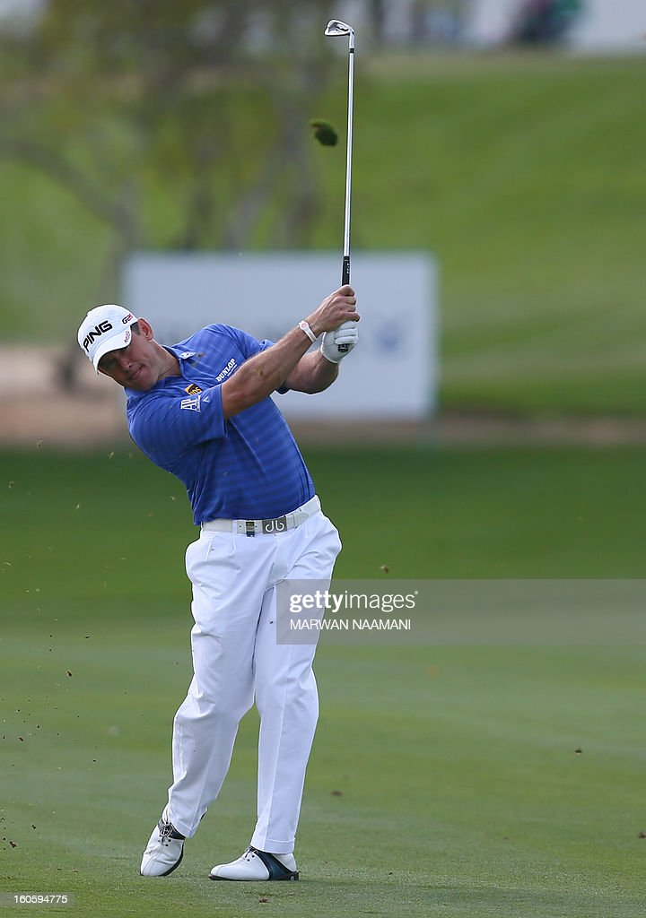 British Lee Westwood plays a shot on the fourth and last round of the Omega Dubai Desert Classic in Dubai, on February 3, 2013. Stephen Gallacher of Scotland fired a timely eagle two on the par-4 16th hole and comfortably won the $2.5 million Omega Dubai Desert Classic in the end by three shots.