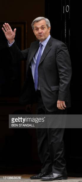 British Liberal Democrat party's Chris Huhne waves as he arrives at 10 Downing Street in central London on May 12 2010 New British Prime Minister...