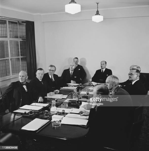 British Liberal National politician Leslie Burgin Minister of Supply pictured in centre as he chairs the first meeting of the Council of Ten advisors...