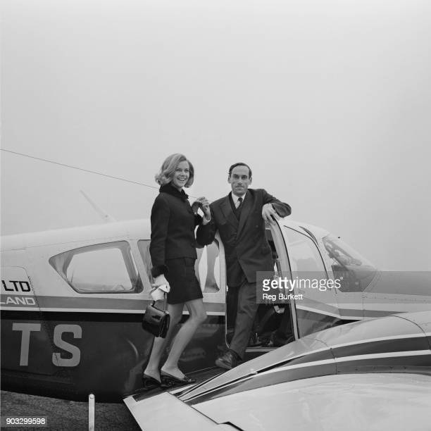 British Liberal Party politician Jeremy Thorpe helps British actress Honor Blackman aboard flight aircraft UK 21st October 1968