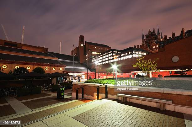 British Library in London with the top of St Pancras Renaissance London Hotel on the top right of the image captured in the evening.