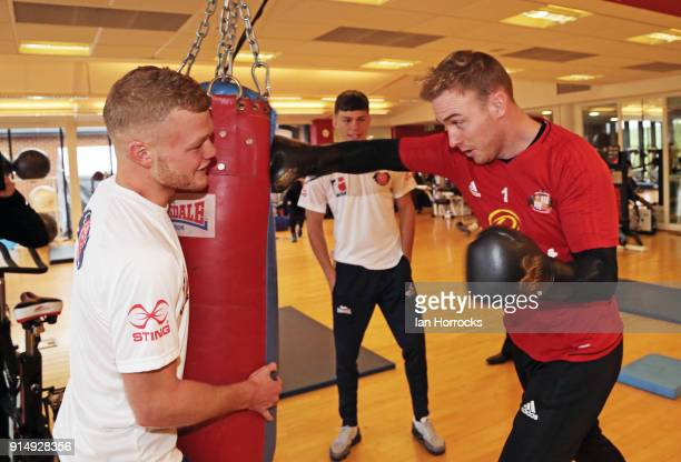 British Lionheart boxer Calum French works with Sunderland keeper Jason Steele during a visit to the Academy of Light on February 6 2018 in...