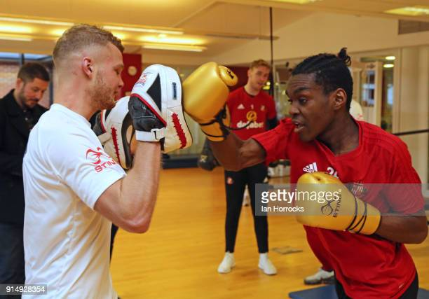 British Lionheart boxer Calum French works with Sunderland player Joel Asoro during a visit to the Academy of Light on February 6 2018 in Sunderland...