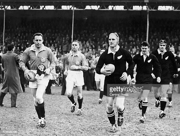 British Lions captain Ronnie Dawson and All Blacks captain Wilson Whineray lead out their teams before the start of the rugby first test at Dunedin...
