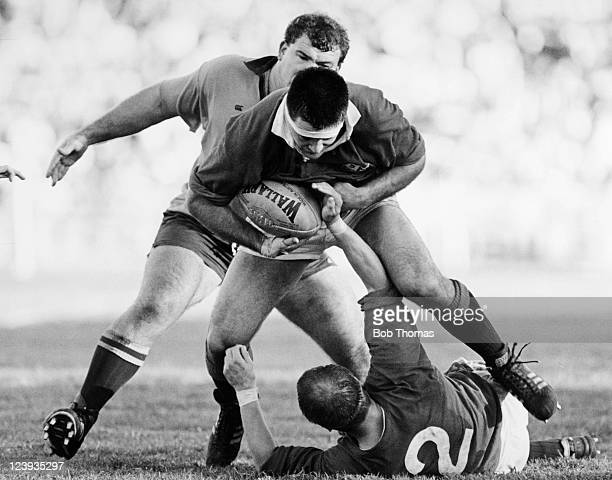 British Lions forward David Sole takes the ball from hooker Brian Moore as Tom Lawton of Australia moves in to challenge during the 2nd Test match of...