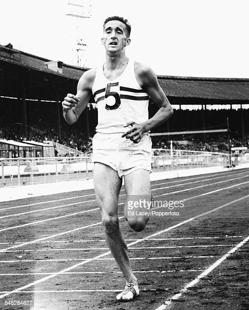 British long distance runner Gordon Pirie competes in a race during a Great Britain versus Commonwealth competition meeting at White City Stadium...