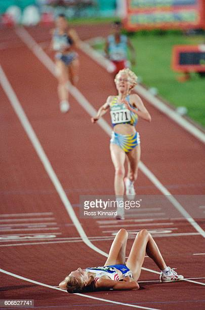 British longdistance runner Paula Radcliffe lies exhausted after finishing the Women's 5000 metres event in fifth place at the Centennial Olympic...