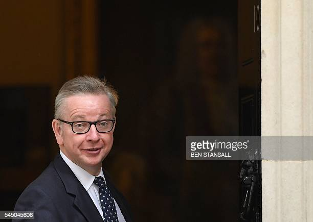 British Lord Chancellor and Justice Secretary Michael Gove gestures as he arrives to attend a cabinet meeting at 10 Downing Street in central London...