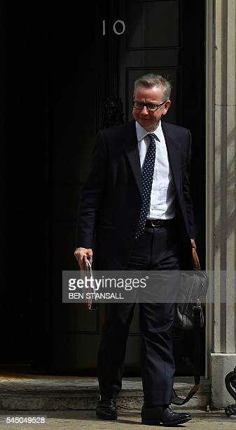 British Lord Chancellor and Justice Secretary Michael Gove reacts as he leavs after attending a cabinet meeting at 10 Downing Street in central...