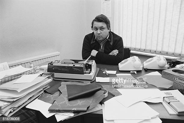 British magazine publisher and sex shop owner David Sullivan posed at an office desk in London on 8th February 1982