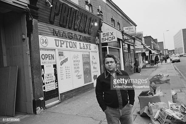 British magazine publisher and sex shop owner David Sullivan posed outside one of his Private shops in Upton Lane East London on 8th February 1982