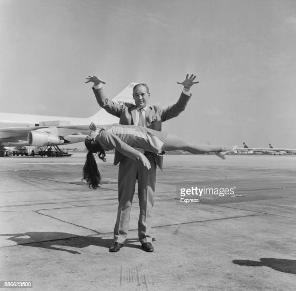 British magician Jeffery Atkins performing his levitation illusion with Jacqueline Moore at Heathrow airport UK 1st July 1971