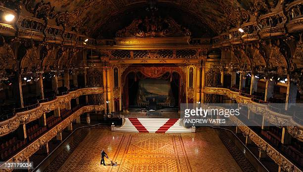 British maintenance engineer Darren Unsworth polishes the wooden floor during the annual cleaning of the ballroom in Blackpool Tower in Blackpool,...