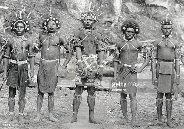 Natives of Celebes Islands in their holiday costume