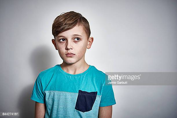British male child looking concerned and worried