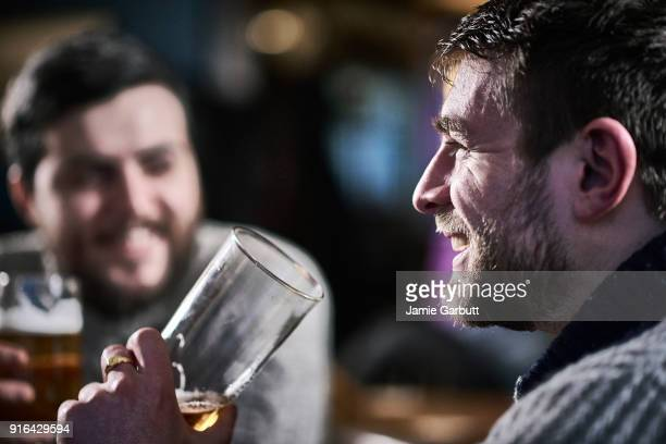 british males drinking a beer in a traditional pub - only men stock pictures, royalty-free photos & images