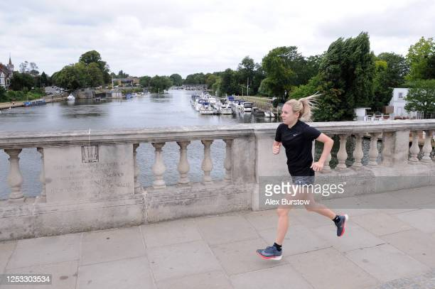 British marathon runner Charlotte Purdue runs across Hampton Court Bridge during a training session on June 29 2020 in East Molesey England