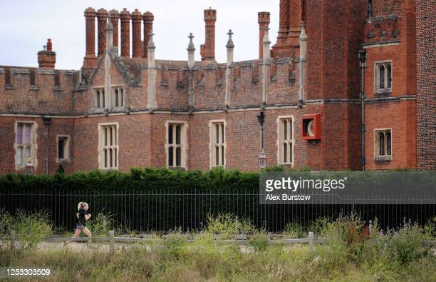 British marathon runner Charlotte Purdue runs next to Hampton Court Palace during a training session on June 29 2020 in East Molesey England