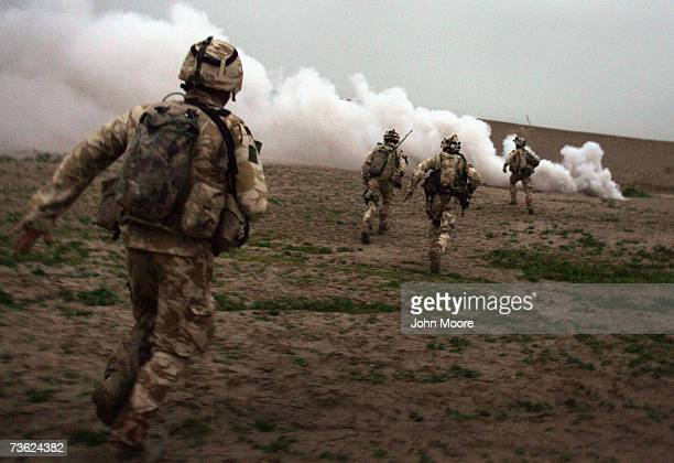 British Marines run towards a Taliban position during a British commando offensive on March 18, 2007 near Kajaki in the Afghan province of Helmand....