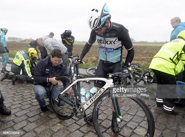 British Mark Cavendish of team Ettix QuickStep checks his bike after a fall during the 77th edition of the GentWevelgem one day cycling race on March...