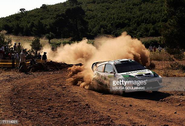 British Matthew Wilson and Michael Orr drive their Ford focus RS at Kineta special stage west of Athens on the third day of the Rally Acropolis 03...
